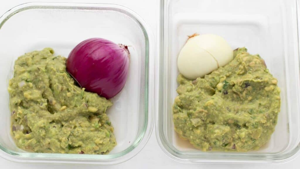 two servings of guacamole stored with onion half on day 3