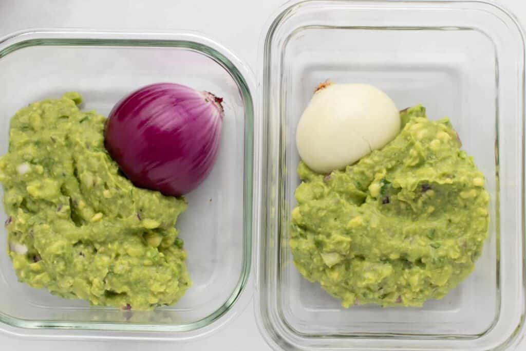 two servings of guacamole stored with onion half on the day it was prepped