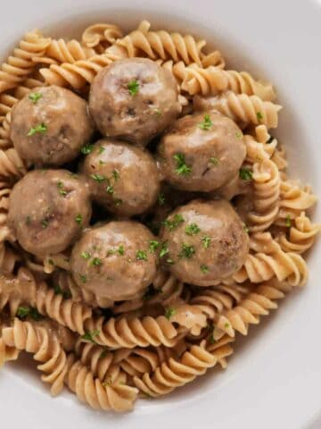 Vegan swedish meatballs made with mushromms with a creamy gravy over whole wheat noddles.