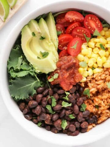 Vegan burrito bowl with Mexican brown rice, spicy black beans, and loads of veggies.