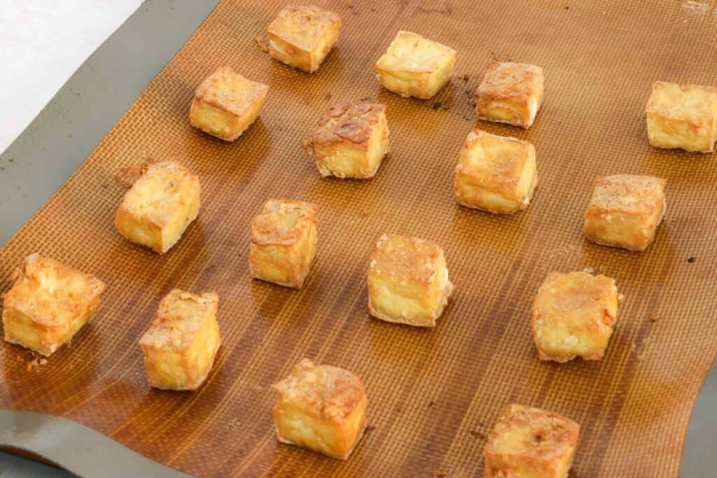 Oil-free crispy oven baked tofu on a baking tray