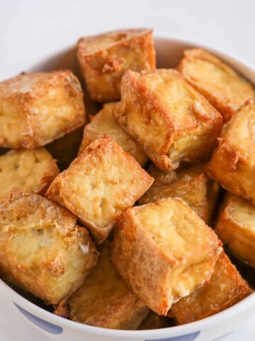 Oil-free crispy oven baked tofu in a bowl