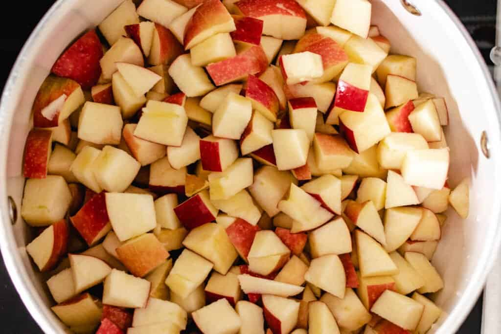 diced apples with peels in a pot