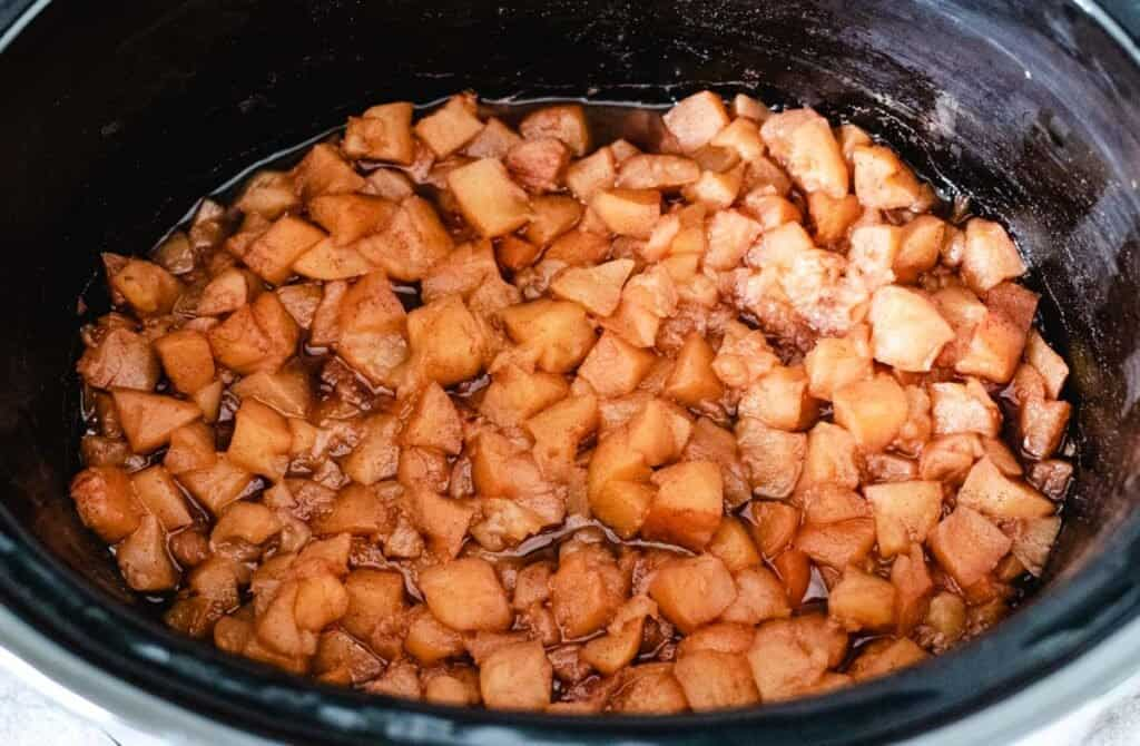 cooked apples with cinnamon in a slow cooker