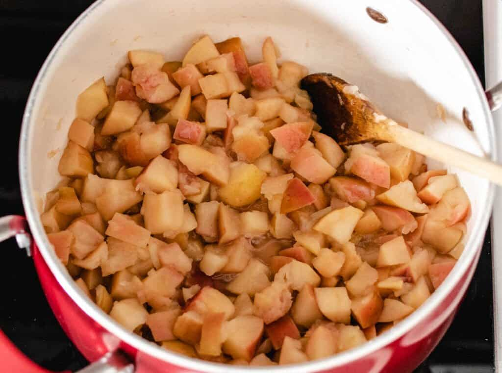 cooked apples with peels in a pot on the stovetop