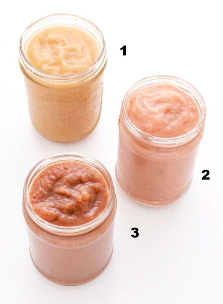 three jars of applesauce, 1. pale color 2. pink color 3. darker in color