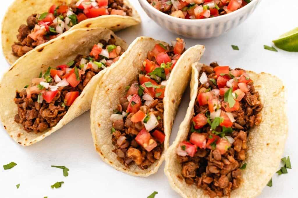 lentil taco meat in corn tortillas with pico de gallo
