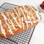 vegan orange cranberry bread on a cooling rack