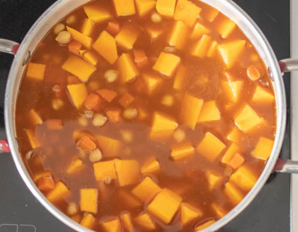 add squash, broth, and chickpeas to curry soup