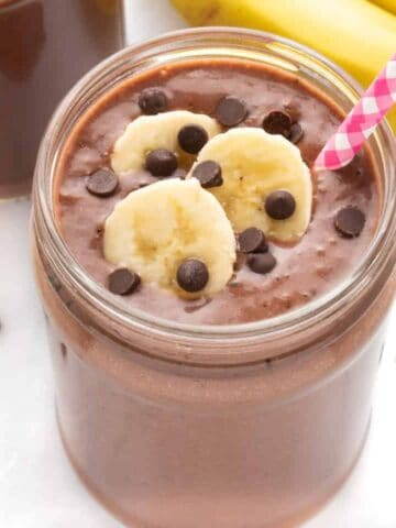 Creamy chocolate banana smoothie with a straw
