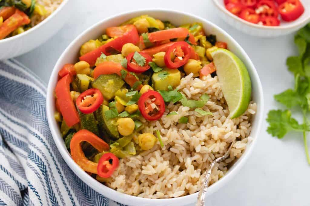 vegetable curry with brown rice in a bowl