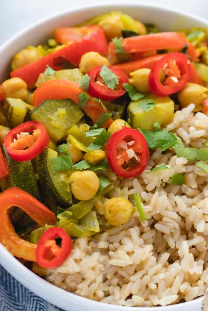 vegan coconut curry with brown rice in a bowl