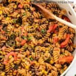 one pot pasta with red bell pepper and black beans in a pot