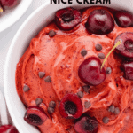 cherry nice cream in a bowl with sliced cherries
