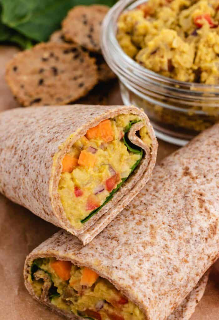 curry mashed chickpea in a wrap with spinach and carrots