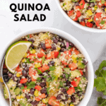 quinoa salad with black beans and lime wedges in a bowl