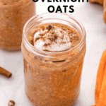 pumpkin overnight oats in a jar with coconut cream and crushed pecans