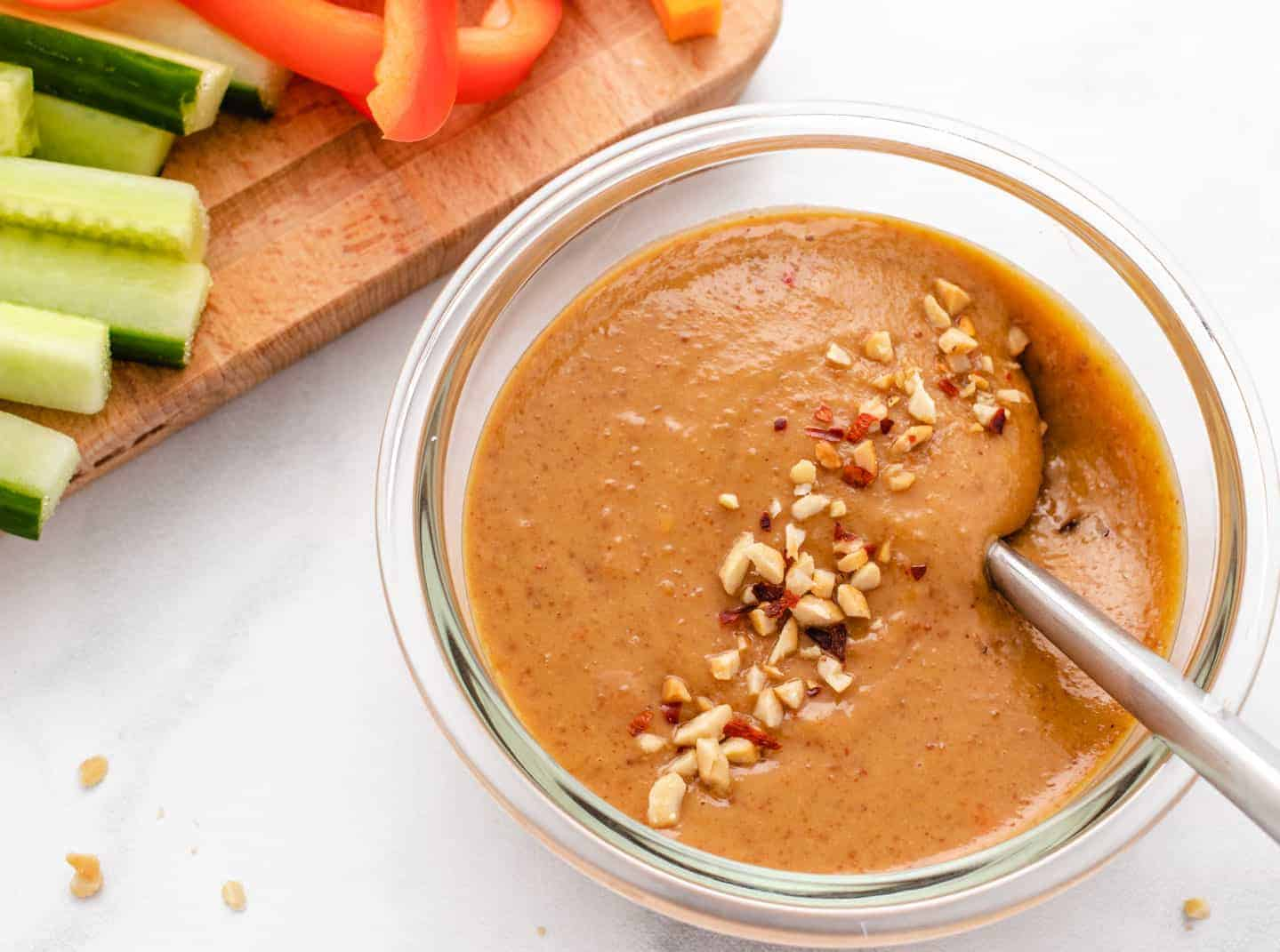 peanut sauce in a glass bowl with a spoon