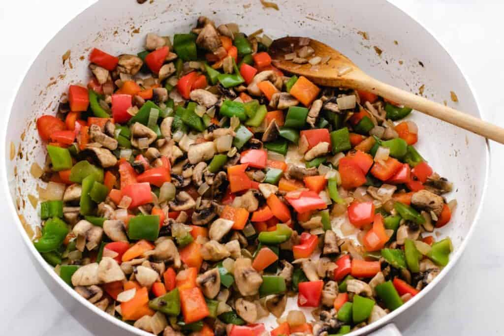 sauteed peppers and mushrooms in a skillet
