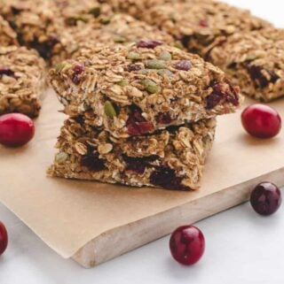 orange cranberry oat bars with cranberries
