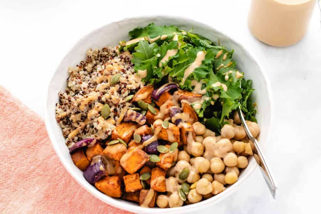 roasted sweet potato bowl with chickpeas in a bowl with kale
