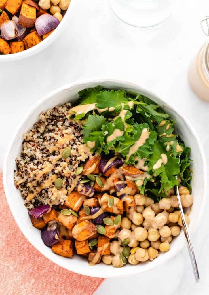 vegan sweet potato bowl with chickpeas and kale in a bowl