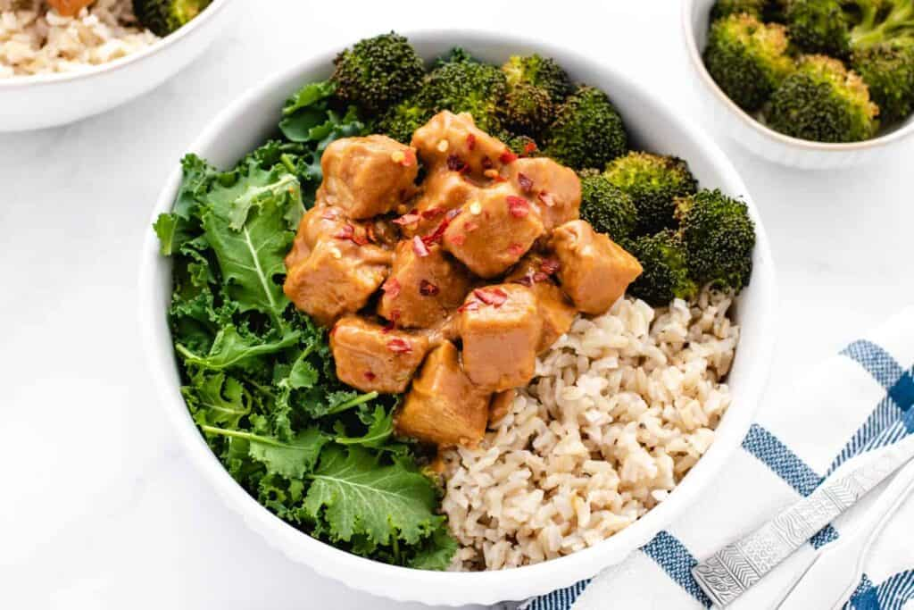 peanut tempeh bowl with kale, roasted broccoli, and rice