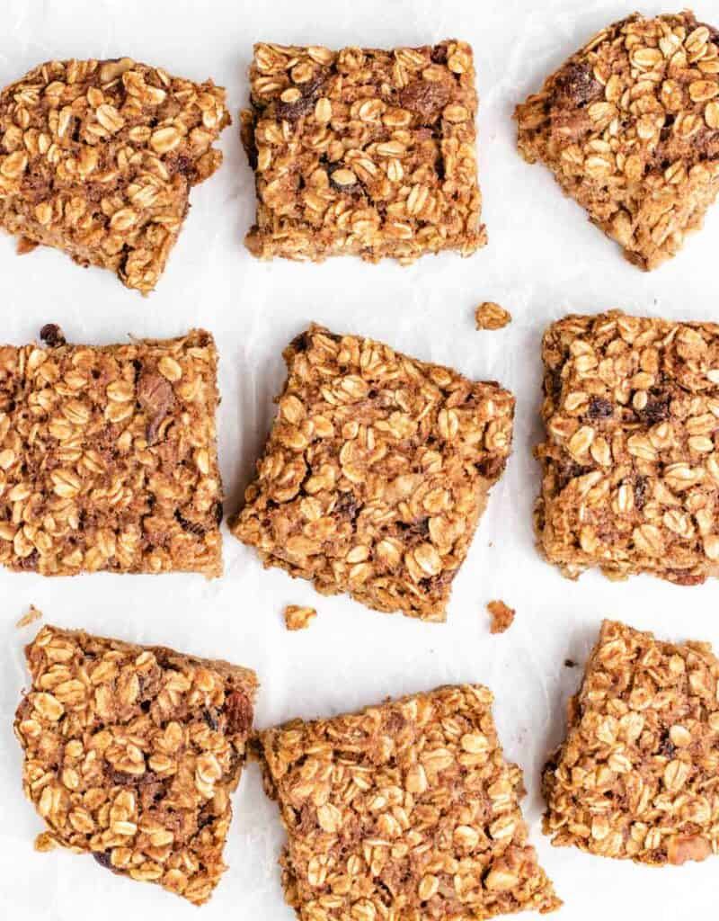 oatmeal bars cut into nine bars on parchment paper