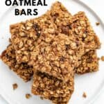 raisin oatmeal bars stacked on a plate