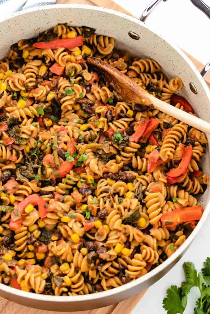 Southwest Pasta with black beans with cilantro in a large pan.
